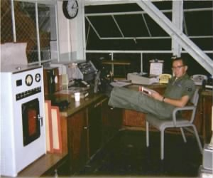 Bill Kover on duty in Control Tower weather observation station.