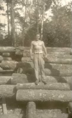 Dad with pose on logs.jpg