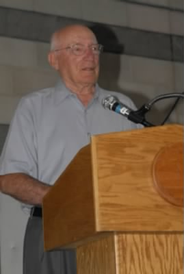 Col Bill Bower, about 90 years old, giving a presentation.