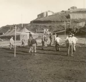 troops playing volleyball on Adak Island in August 1943