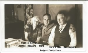 Herb with his parents prior to going over seas,  likely Dec. 1942