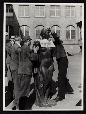 Six men prepare an Aristide Maillol sculpture looted during World War II for transport to France.jpg