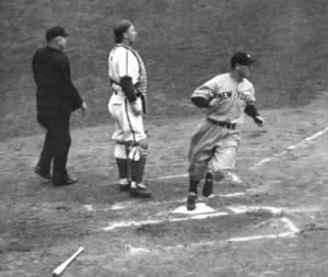 Lou Gehrig scores the first run of the 1938 World Series against the Chicago Cubs.Photo AP.jpg