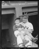 1938 - catcher Moe Berg with batboy Donald Davidson at Fenway Park.jpg