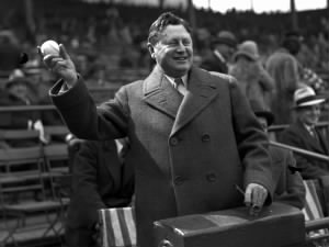 William Wrigley Jr. throws out the first ball for opening day at Wrigley Field, circa April 22, 1930..jpg