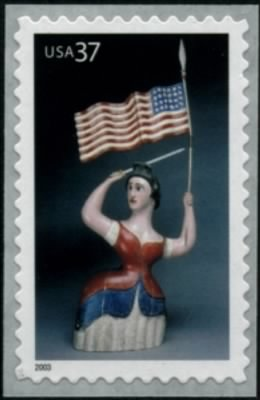 Carving of woman with flag and sword, 19th century.jpg